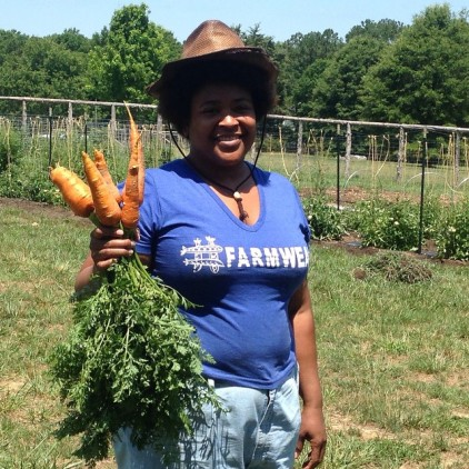 Lisa, one of the volunteers, with some Danver carrots.